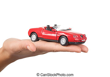Car on hand - Close-up of red toy car on female?s palm over...
