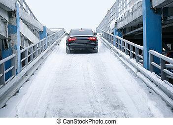 car on many-tier parking in the winter