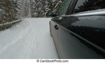Car on moutain way. Driving on snowy road