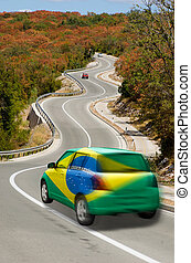 Car on road in national flag of brazil colors