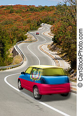 traveling car in national flag of ecuador colors and beautiful road landscape for tourism and touristic adertising