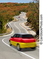 Car on road in national flag of germany colors - traveling...