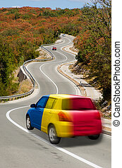 Car on road in national flag of romania colors