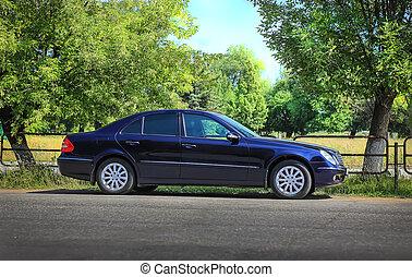 car on roadside  - dark car on roadside near park