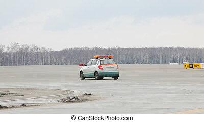 Car on Runway