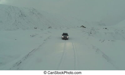 Car on Snow-Covered Road in Mountains, Bird Eye View -...