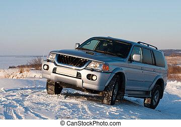 Car on snowy hill - Four wheel drive vehicle on snowy hill