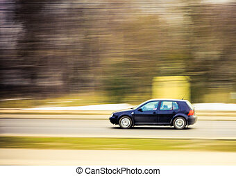 Car on the move, motion blur