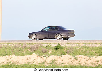 car on the road in motion