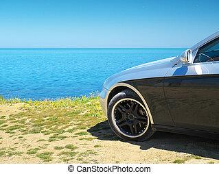 Car on the sea shore.