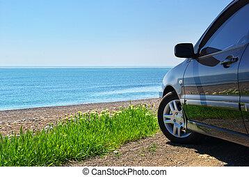 Car on the sea shore. Travel design.