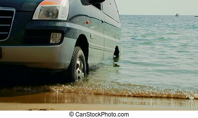 Car on the shore