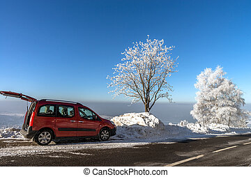 Car on the winter road in mountains. Sunny day. Picturesque and gorgeous wintry scene.