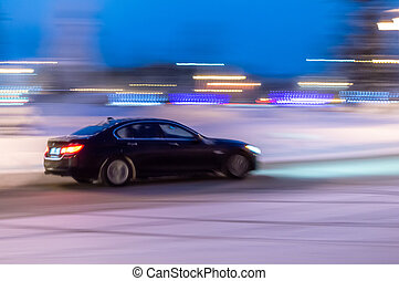 Car on winter road in the evening.