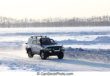 Car on winter road.