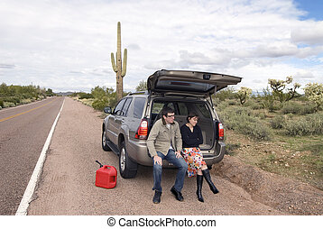 Car out of gas - Two people are stranded on the side of a ...