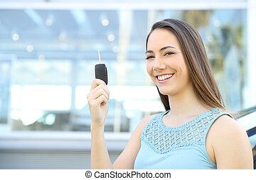 Car owner showing keys after buy