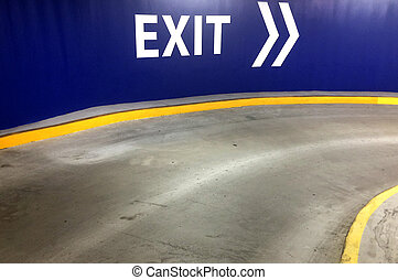 Car park exit sign with directional arrow