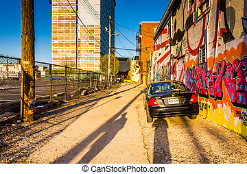 Car parked in Graffiti Alley, Baltimore, Maryland.