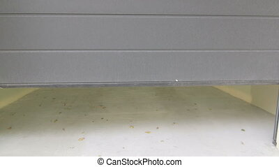 Car parked in the garage with automatic door POV