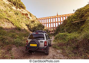 Car parked off road by Nerja Roman bridge, Spain