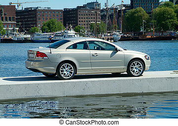 Car parked on a floating pier - Sportscar parked on a ...