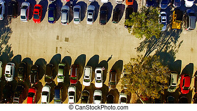 Car parking aerial view. Multiple rows of vehicles