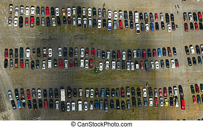 Car Parking Lot Aerial - Overhead view of cars parked...