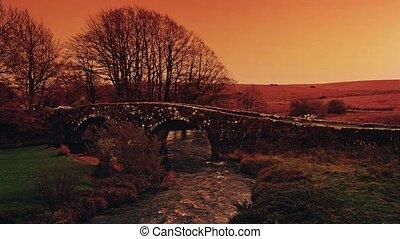 Car Passes Over Old Bridge Sunset