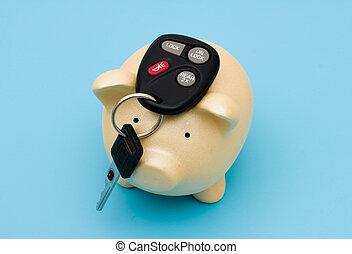 car payment - car keys on top of a piggy bank on a blue...