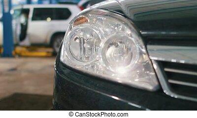 Car preparing for professional diagnostics in auto service, close up