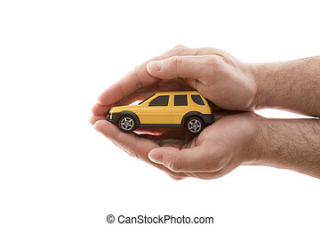 Car protection. Small yellow car covered by hands isolated on white background with clipping path