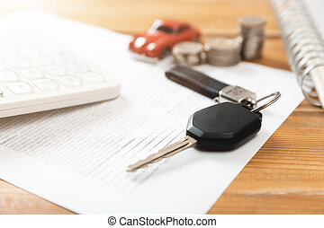 Car purchase concept. Car keys, calculator, toy car, coins and purchase contract