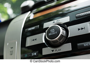 Car radio - Close up of car radio with focus on the volume...