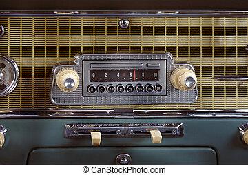 Car radio in retro automobile closeup photo