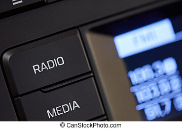 Car radio knob close-up. Digital media in car interior