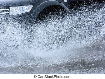 car rain puddle splashing water - motion car rain big puddle...