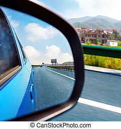 Car rearview mirror and highways - From the inside rearview...