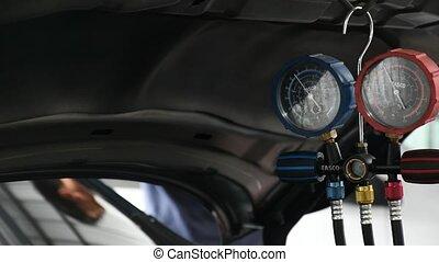 Car refilling air condition - Bangkok, Thailand - May 15,...