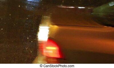 Car Reflection in Raindy Day on Road Asphalt