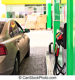 petrol station - Car refueling on a petrol station .