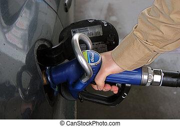 Car refuelling - Man refuelling his car