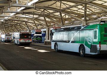 Denver International Airport - Car rental buses drop off and...