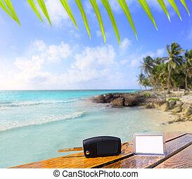 Car rental keys on wood table in vacation Caribbean - Car...
