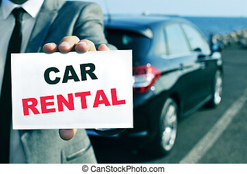 car rental - a man in suit holding a signboard with the text...