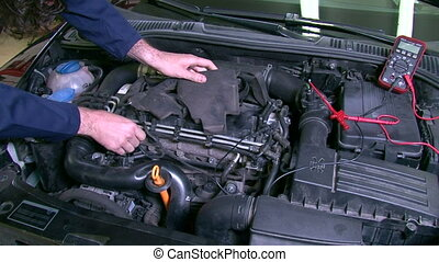 Car Repair Cheking Diesel Engine - Mechanic checking a...