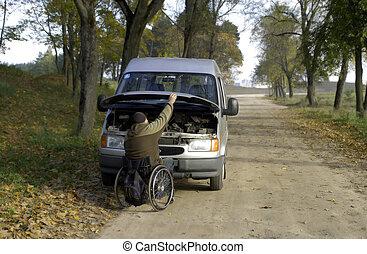 Car repair - Disabled men repair car in forest