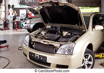 Car Repair Shop - A car in a professional auto repair shop...