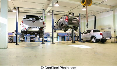 Car repair shop, crane shot