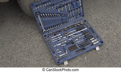 Car repair tools on the street near the wheel on asphalt -...
